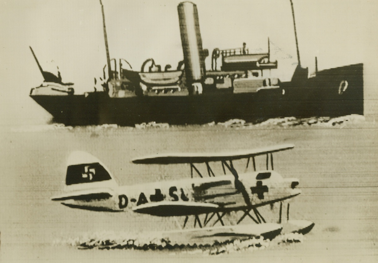 CAPTURE NAZI PLANE DISGUISED WITH RED CROSS, 7/30/1940  LONDON – A German seaplane marked with the Red Cross down on the sea after being captured by the British royal air force, who shot down two such planes yesterday.  According to British authorities German planes bearing the Red Cross have been making scouting flights over British convoys and doing other reconnaissance work in violation of international law, and henceforth would operated near the British Isles at their own risk.  In the background is the boat that picked up the crew of the German plane.  Passed by British censor and sent to New York by Western Union cabel, July 30th.Credit: Acme;